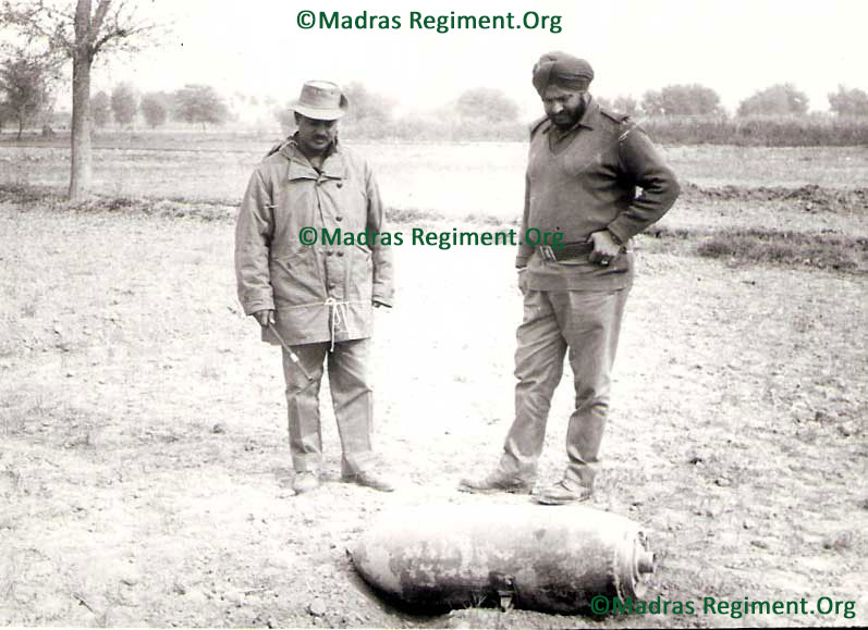 1971 War - The famous 500 pounder that  dropped 5 yds from the C.O.'s bunker during the Pak Air raid by Sabres, but failed to explode. Note the missing fin which may have been the reason it possibly dropped on its side and did not explode. Lt Col J Kumar and unidentified Artillery Major